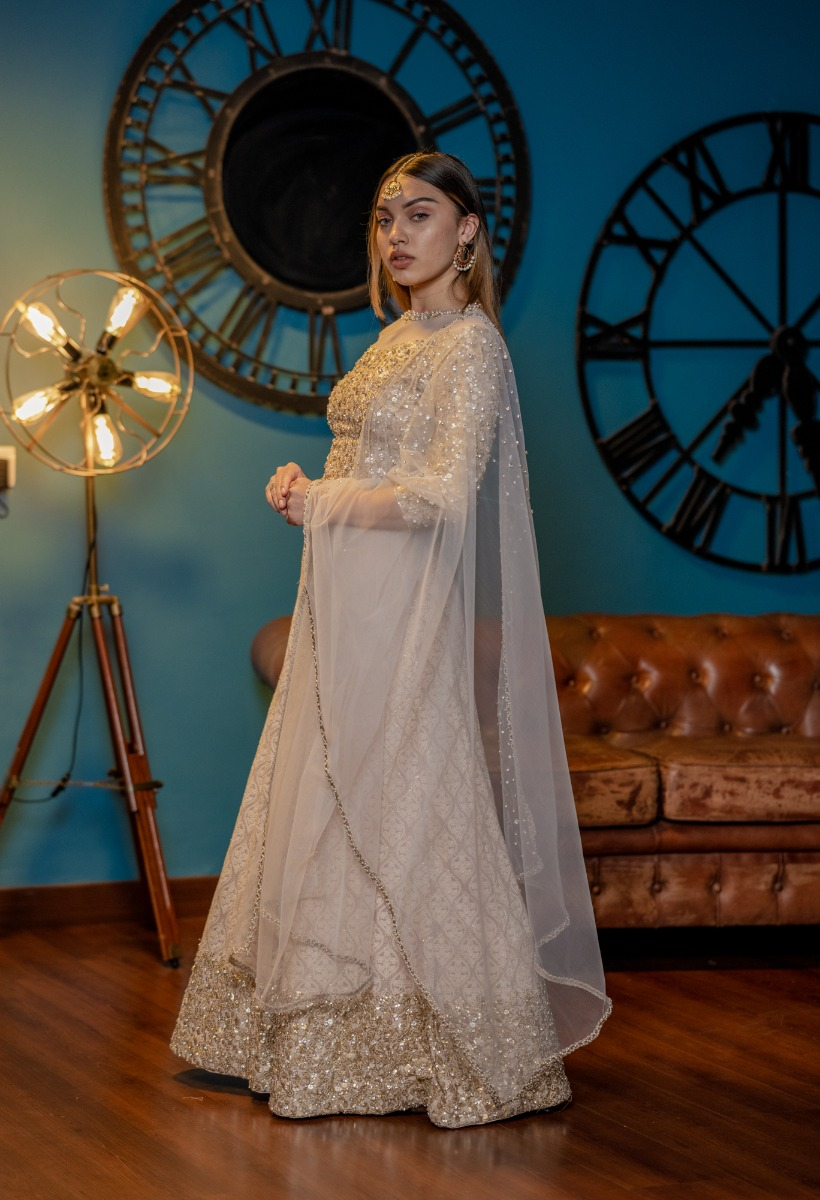 Pastel Pink Bridal lehenga with Heavy Rhinestone embellisehed blouse and Luchnowi skirt with an embalorate work border and dupatta