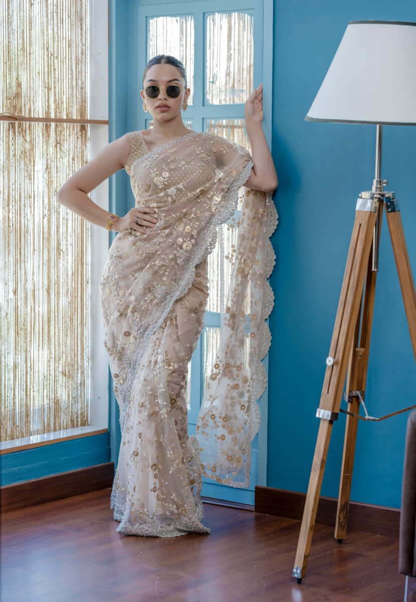 Pastel Shade Blush pink Shade Bridal saree with heavy borders with a scalloped edging