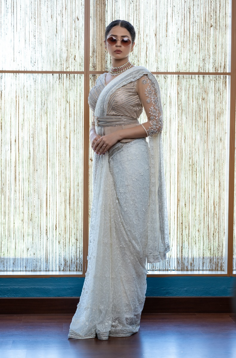 Offwhite lace work over georgette Bridal saree with hand embellished silver  cutbead border paired with heavy embroideed yet stylish Trumphet blouse