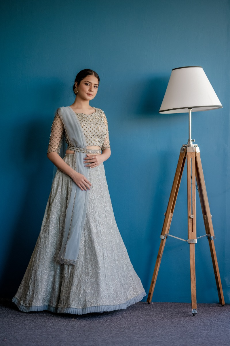 Powder Blue Luchnowi Bridal lehanga with hand embellisehed blouse and scalloped edge dupata teamed with a belt