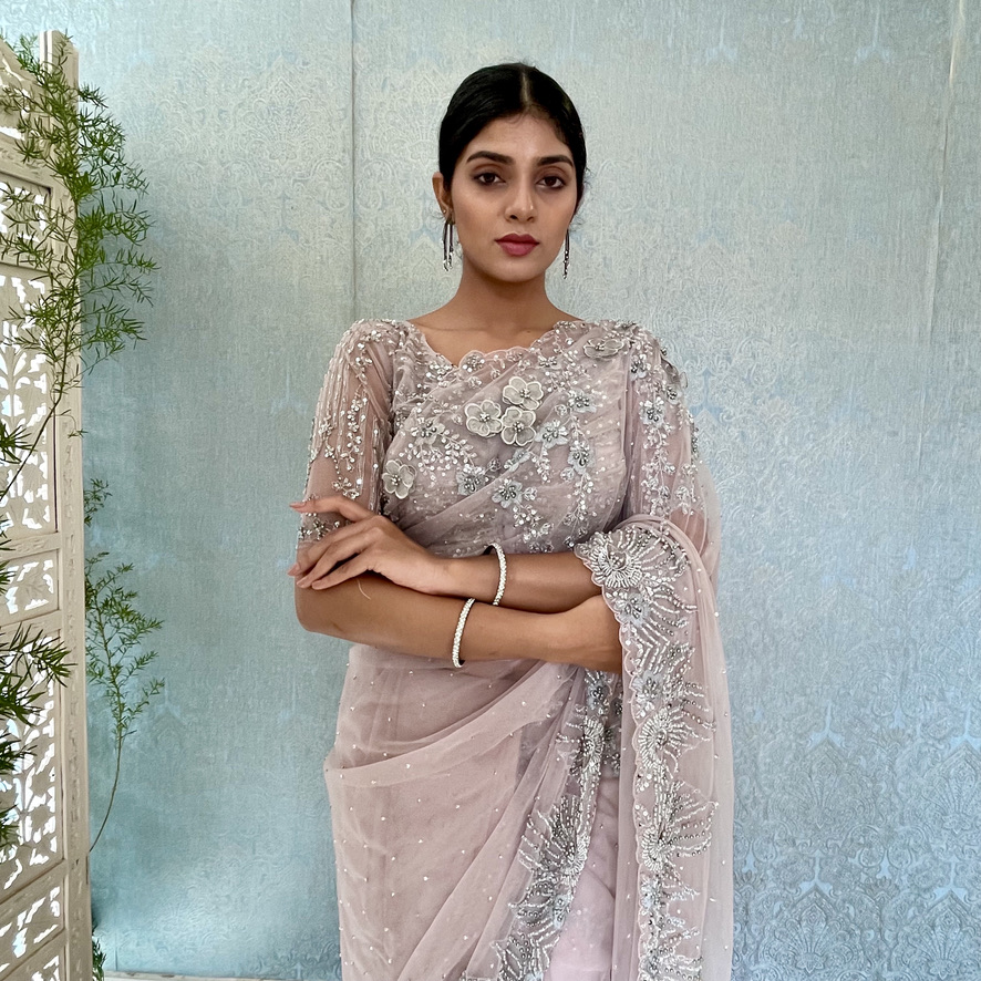 Soft Lavender Hand embroidered tulle net wedding saree  with heavy beaded border with flowers and heavy blouse