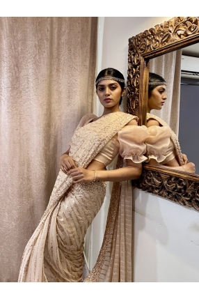 Rosegold georgette Bridal saree with hand work done with Rhinestones, beads, sequin