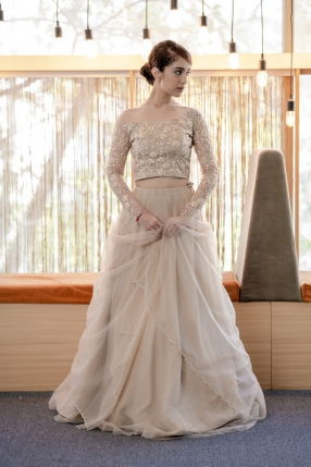 Nude peach Pastel Bridal Lehanga with hand embellished blouse, stripped skirt, scalloped edged Dupatta