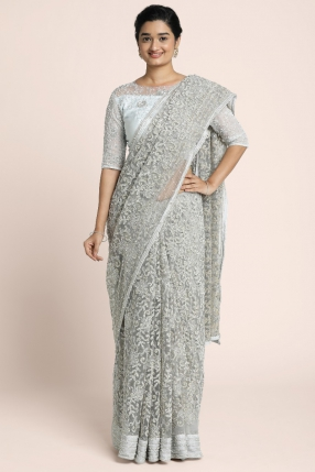 Corded lace silver saree on net with line pattern border embellished with nakshi , sugarbeads and crystal stones