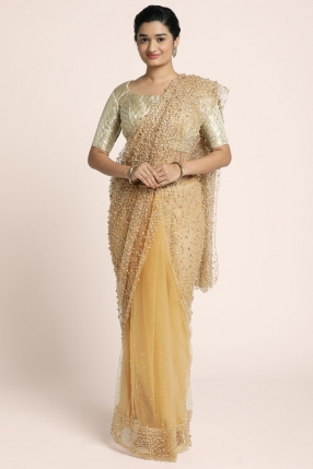 Partly golden beige net  saree with heavy bead work