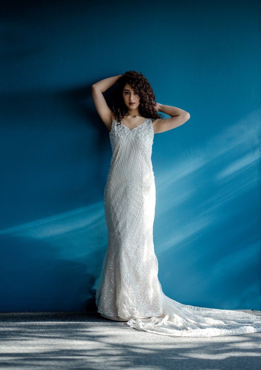 Mermaid White Lace Wedding Gown over champagne with a long trail