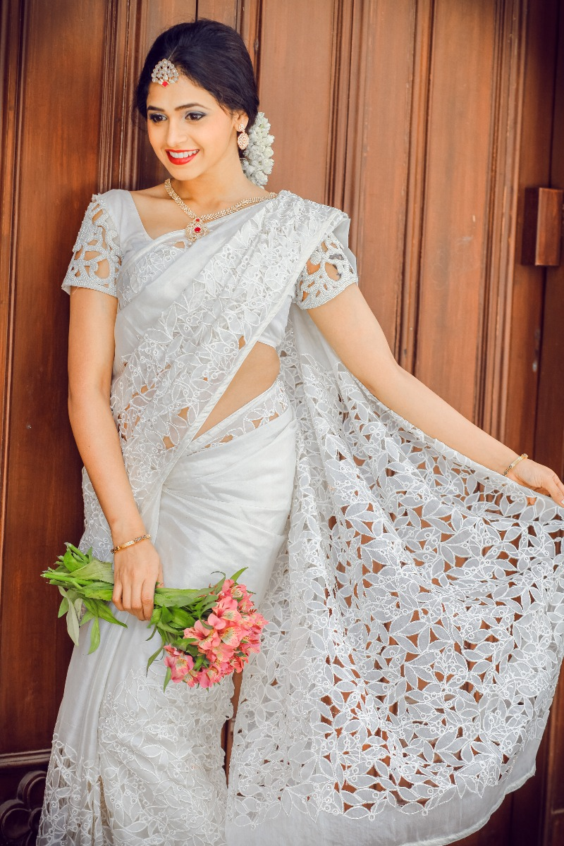 Beautiful Signature cutwork Bridal Saree from our collection  Worn by Lovely bride