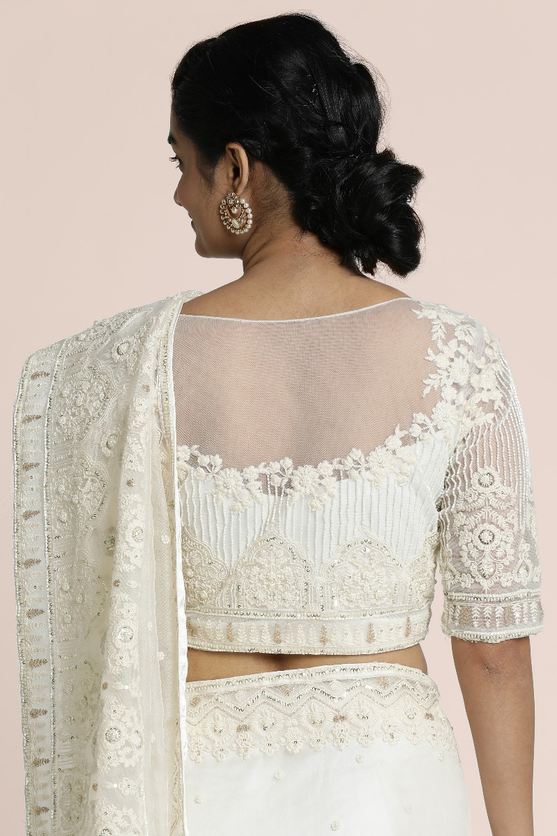 Offwhite oraganza wih thread embroidred borders highlighed with sequin pearls and cutbeads