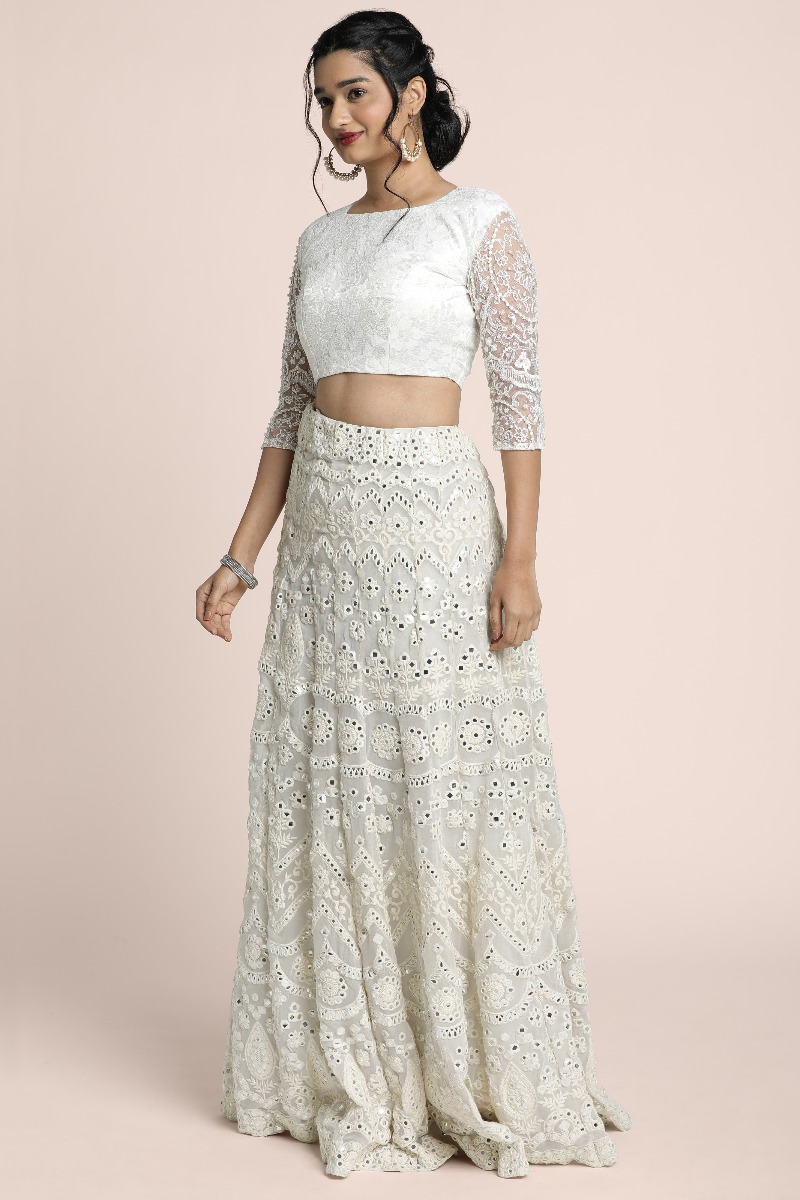 Fully mirror work thread embroidered skirt paired with crop top with heavy embellished sleeves