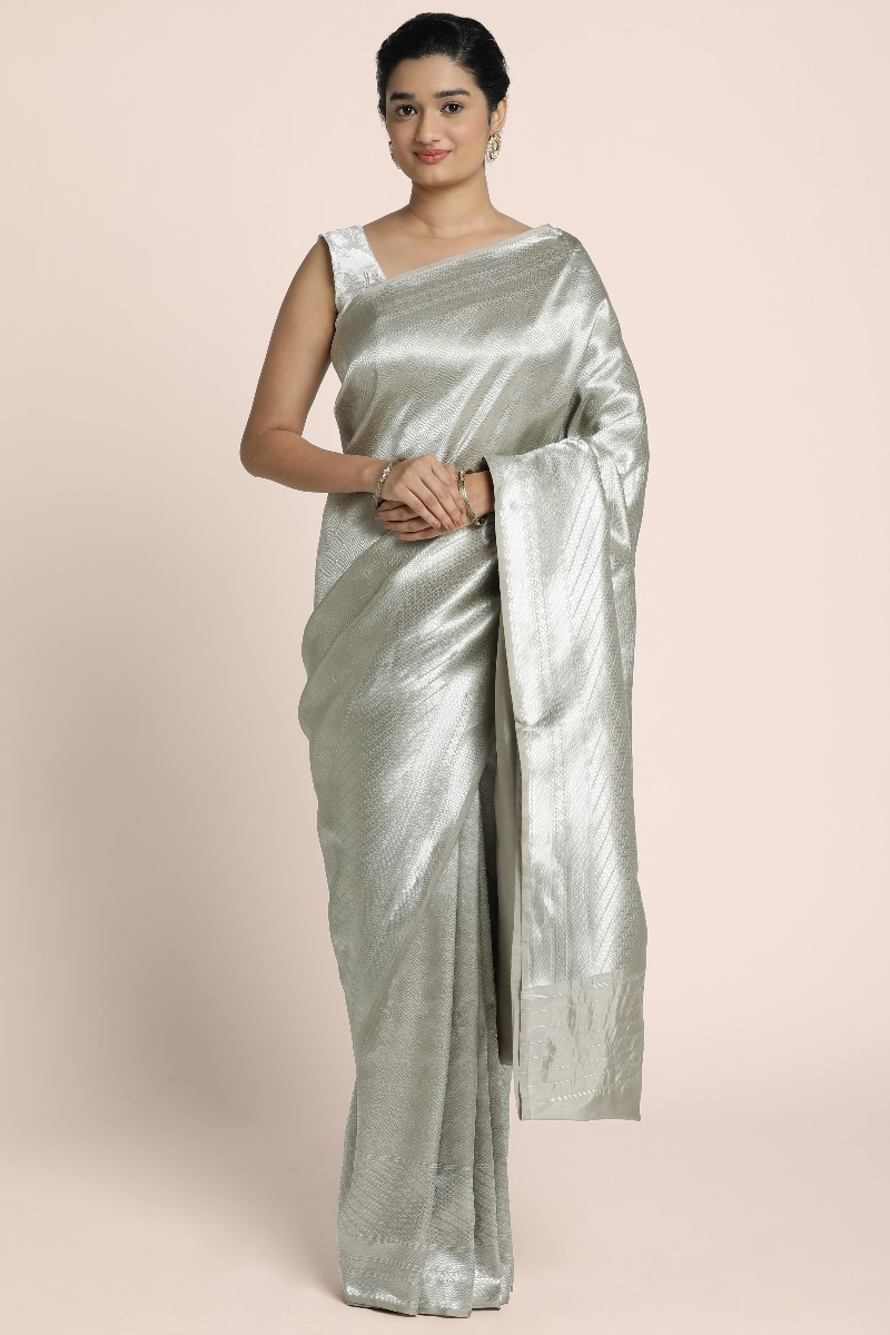 Pure Banarasi Silver shade saree with intricate design and beautifull borders and pallu
