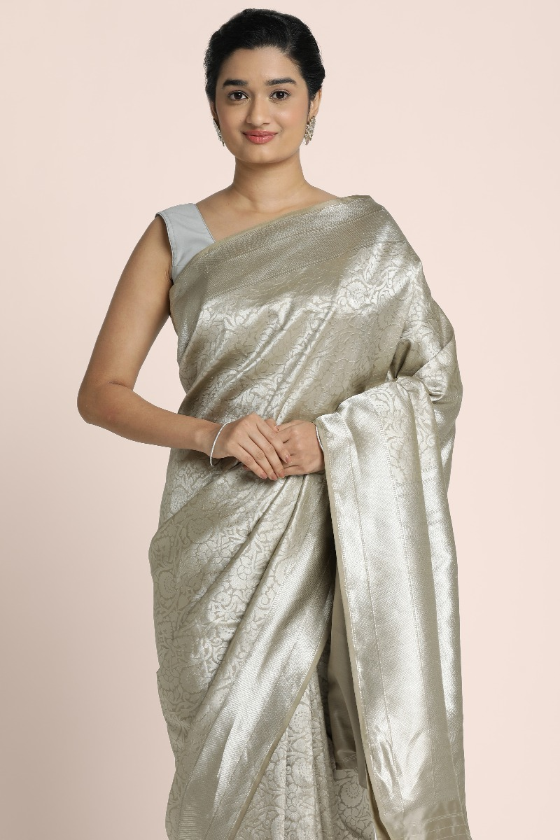 Pure Bnarasi Silver shade saree with intricate design