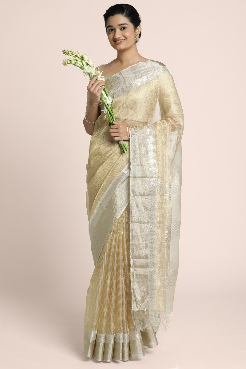 Benarasi tissue saree with a subtle combination of light gold and elegant silver border