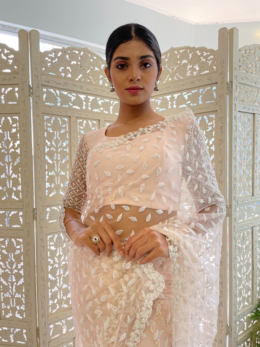 White Clustered Sugarbead work on soft pink tulle net bridal saree with heavy hand embroidered blouse