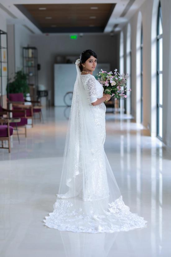 Pearl white heavy beaded intricate small floral hand emboidered work on fully embroidred saree
