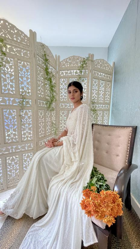 Matt Sequin embellished offwhite georgette bridal saree with Oval bead work and embossed floral work