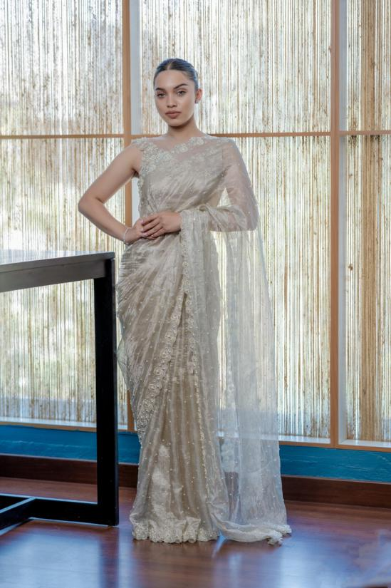Hand embroidered Silver tissue Wedding Saree paired with illusion neck heavy embroidered offshoulder blouse