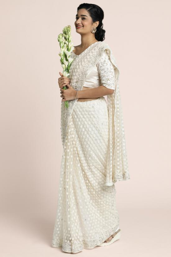 Fully handembroidered saree on pearl white organza with heavy embroidered blouse