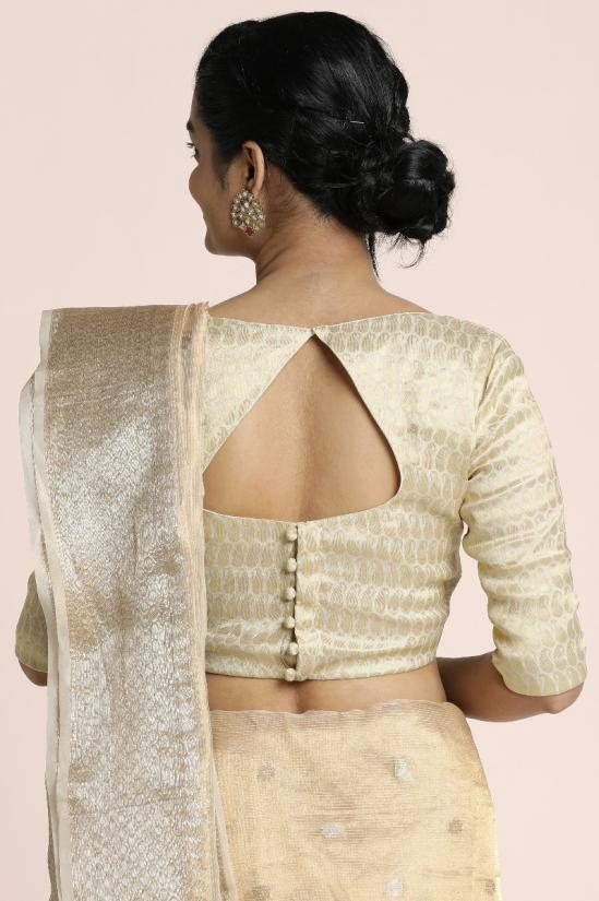 Benarasi tissue saree in light golden with intricate design border in silver and heavy pallu